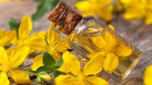 hypericum oil in a glass bottle macro horizontal